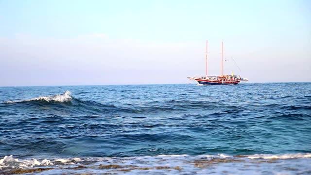 Traveling sailboat on sea