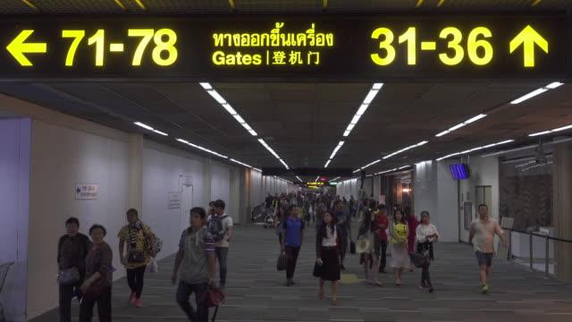 Traveller walk away at the airport terminal