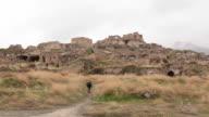 Traveller walking into Hasankeyf remains