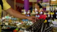 Traveller with local vendors on a Caribbean market