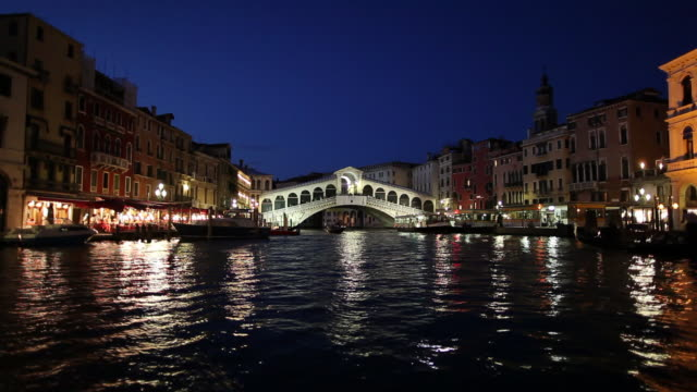 WS BOAT POV Travelling along Grand Canal at night / Venice, Italy