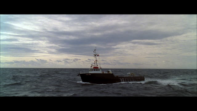 TS Trawler corkscrewing and rolling in a heavy, rolling sea