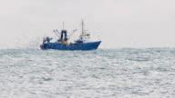trawler fishing in the haze