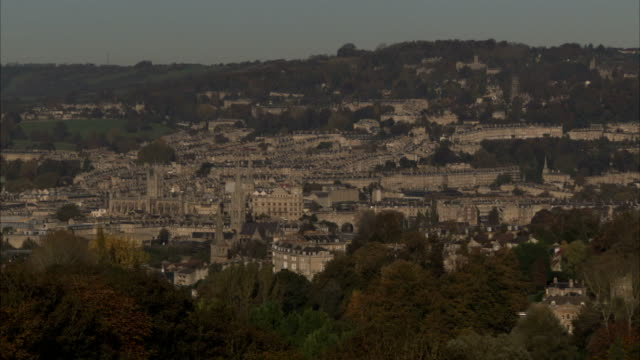 Treetops overlook the city of Bath. Available in HD.
