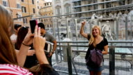 Trevi fountain June 2014 Rome Tourist by the fountain fenced during renovation The fountain is under restoration which will be sponsored by Italian...