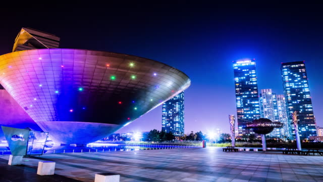 MS T/L Tri bown sculpture building behind Songdo Business District and Park / Incheon, South Korea