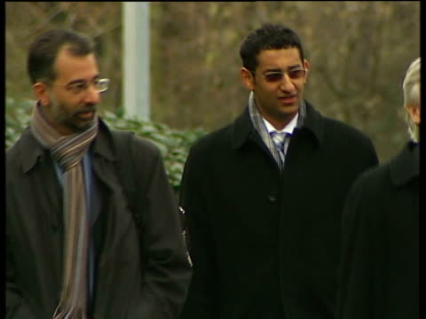 Trial of men accused of attempted bombings on 21st July 2005 court arrivals Various of Adel Yahya along and into court with legal team including...