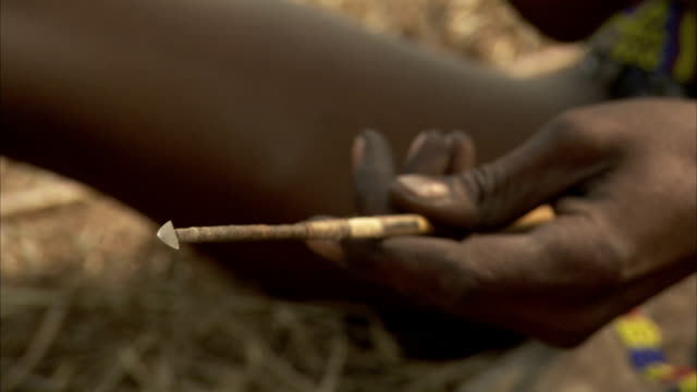 A tribesman holds a dart in his hands. Available in HD