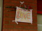 A tribute on a wall reads 'Brixton Love' at the site of a nail bomb attack in Electric Avenue Brixton 1999
