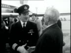 Trident's first passenger flight ENGLAND London London Airport 'BEA' another plane in background Passengers board the plane Pilot speaks to man they...