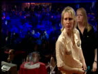 Trina Gulliver at the oche Dawn Standley walks behind her 2003 Embassy World Darts Championships Lakeside Frimley Green