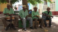 Trinidad, Cuba: street musicians playing traditional acoustic music to tourists visiting the Unesco World Heritage Site in daytime