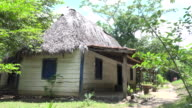 Trinidad, Cuba: Traditional abandoned farmer house in 'El Cubano' natural reserve. The traditional wooden construction in the way to the waterfalls has become a tourist attraction as many stop by to take a rest
