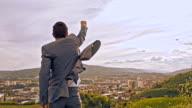 SLO MO Triumphant businessman punching the air