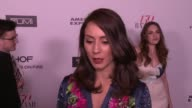 INTERVIEW Troian Bellisario on what brings her out what being fashionable/stylish means to her and who her style icons are at the Harper's BAZAAR...