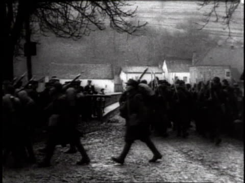 Troops marching in formation with riffles on shoulders / Germany