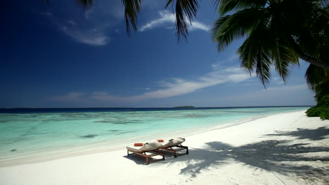 Tropical beach and sun loungers, Maldives, Indian Ocean