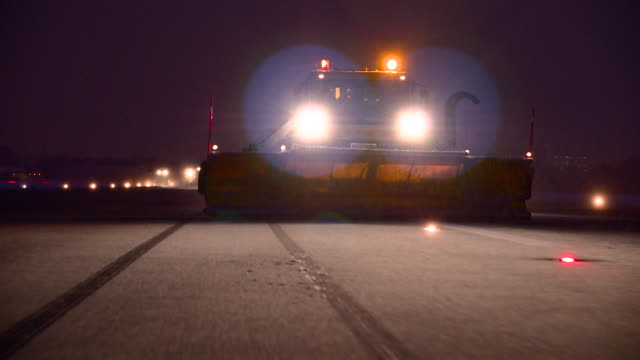 Truck deicing a road