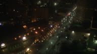 TS A truck driving down a narrow city street until stopping at a roadblock with a very bright light, where it reverses / New Orleans, Louisiana, United States