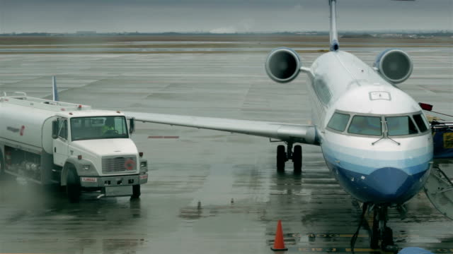 Truck leaves after servicing airplane