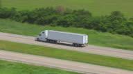WS TS ZO AERIAL POV Truck moving on road in farmland / Iowa, United States