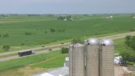 WS TS ZI AERIAL POV Truck moving on road in farmland / Iowa, United States