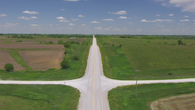 WS AERIAL POV Truck moving on road near field / Madison County, Iowa, United States