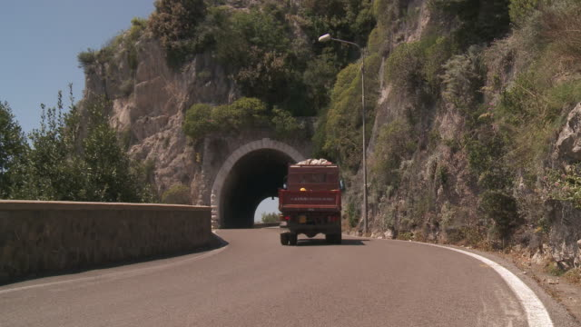 MS Truck moving under tunnel in rock at Amalfi coast / Amalfi, Campania, Italy