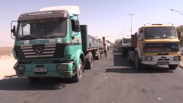 Trucks and rigs wait in line as they try to cross the Ibrahim Khalil border gate due to the international flight ban against Iraqi Kurdish Regional...