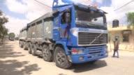 Trucks loaded with construction materials cross into Gaza from the Karm Abu Salim border crossing on May 23 2016 Munir Ghalban Director of Karim Abu...