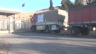 UN trucks loaded with humanitarian aid cross into the wartorn Syrian city of Aleppo from the Turkish border town of Cilvegozu in the southern...