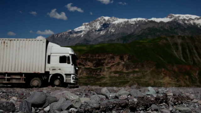 Trucks on the neck of the mountain road.
