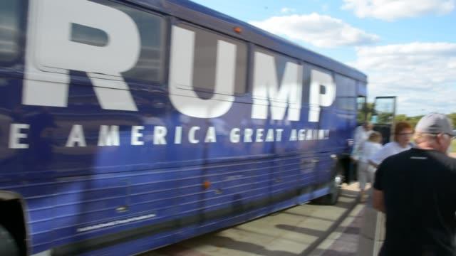 Trump bus arrives and unloads Trump staff