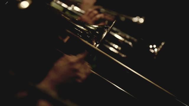 Trumpet and trombone playing jazz music
