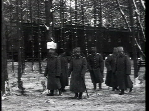 HA Tsar / Czar Nicholas II arrives by train in forest Imperial Army Generals wait and meet on the platform The Russian Emperor walks through snowy...