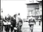 Tsar Nicholas II congratulating and kissing on cheeks lowranking officers at Easte soldiers posing for photograph with Tsar Nicholas II Russian...