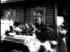 Tsar Nicholas II leaving his headquarters at Baranovichi in a car Grand Duke Nicholas Nicholaevich following in second vehicle officers saluting /...
