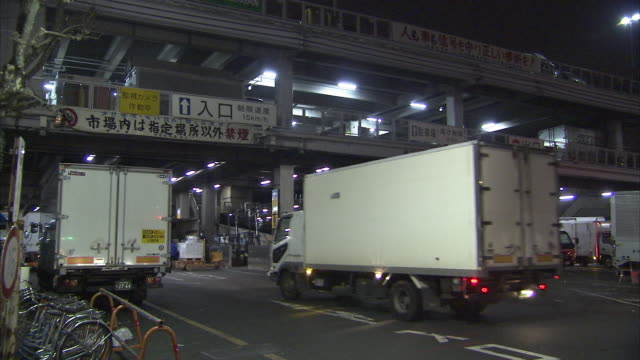WS Tsukiji fish market exterior with trucks, Tokyo, Japan