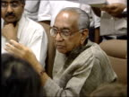 Tsunami aftermath India INDIA Delhi INT Pranab Mukherjee and assistant at press conference Martin Geissler asks him lots of questions and he gets...