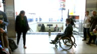 Tube stations to become more accessible to disabled people ENGLAND London EXT George Fielding boarding train with help of rail workers and ramp...