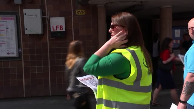 GVs Liverpool Street Station More of RMT Picket line mostly ignored by passers by / Man stopping and wishing striking workers well SOT / Chain across...