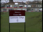 More cases discovered in schools ITN LIB ENGLAND Leicester GV sign 'Welcome to Crown Hills community college' School pupils in playground