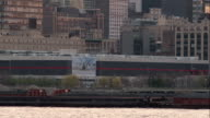 Tugboat Pushing a Barge Down the Hudson River