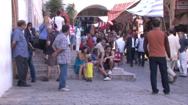 Tunisia already destabilised by a political crisis tightened security on Thursday after two failed suicide bombings that dealt a blow to the countrys...