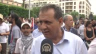 Tunisian antigovernment demonstrators rally against controversial law exempting officials accused of corruption on Avenue Habib Bourguiba in Tunis...