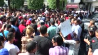 Tunisian people stage a demonstration on Habib Bourguiba Avenue in Tunis Tunisia on May 22 2017 in support of protesters who demand more job...