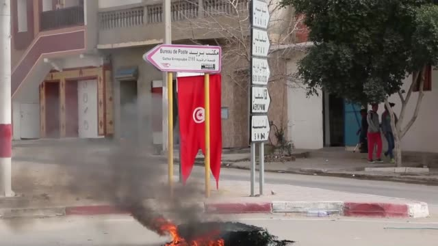 Tunisian protesters blocking the road during clashes with policemen in Kasserine Tunisia on January 21 2016 Reports state one policeman was killed in...