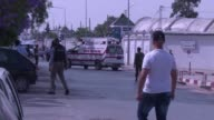 A Tunisian soldier opened fire on comrades at a barracks near parliament on Monday wounding some of them the defence ministry said