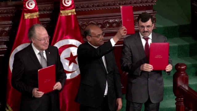 Tunisia's leaders on Monday signed the new constitution adopted by lawmakers during the night a key goal of the revolution three years ago that...