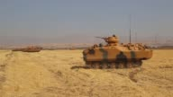 Turkey launches a military drill featuring tanks close to the Iraqi border the army says a week before Iraq's Kurdish region will hold an...
